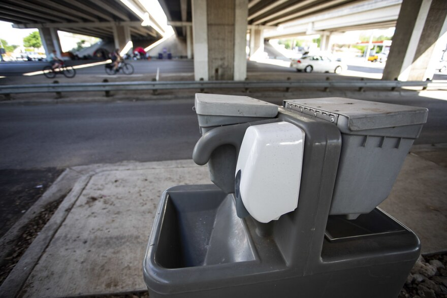 Portable bathrooms and hand washing stations were installed near a camp for people experiencing homelessness in South Austin during the pandemic.
