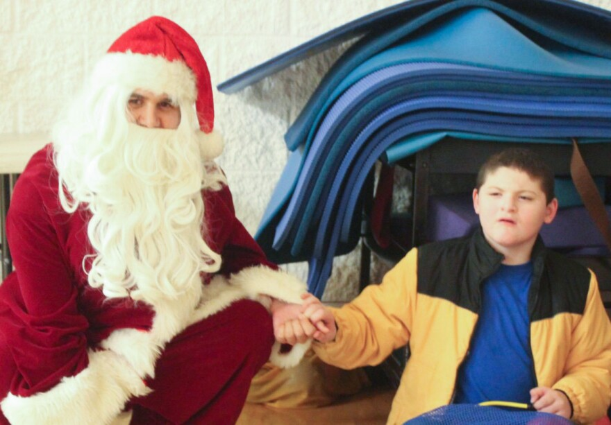 'Santa' Jared Raymer and Paul Smith pose for a Christmas portrait.