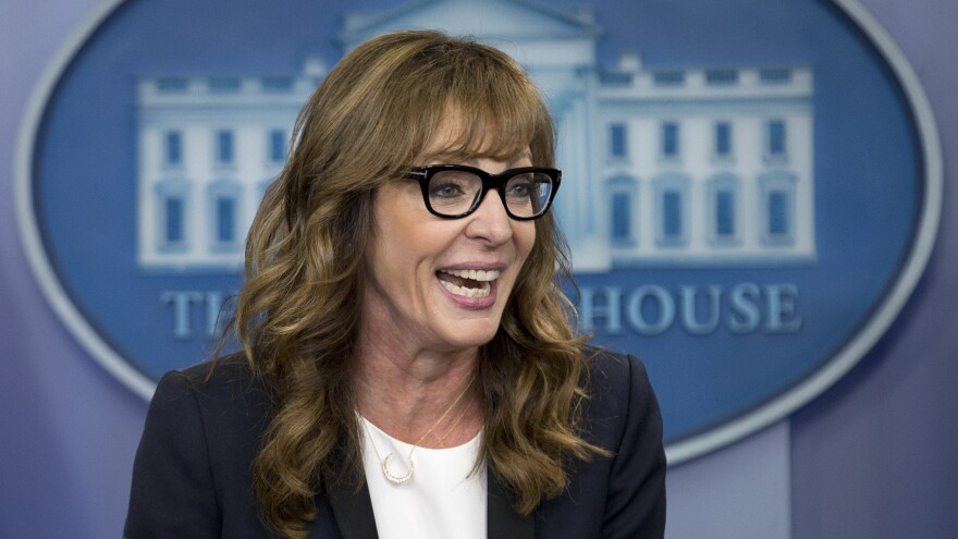 Actress Allison Janney makes a surprise visit to the daily news briefing at the White House on Friday.