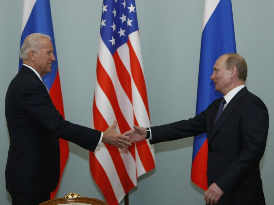 Vice President Joe Biden shakes hands with Vladimir Putin, then Russia's prime minister, in Moscow in 2011.