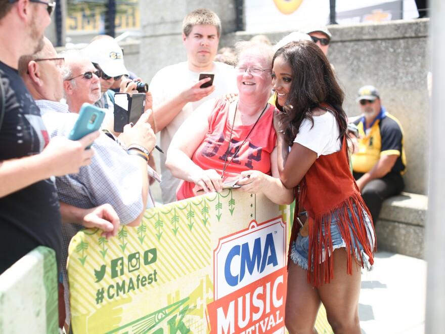 Guyton, greeting fans during CMA Music Fest on June 12, 2016 in Nashville.