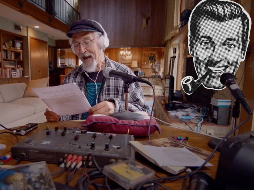 """Doug Smith, aka Rev. Ivan Stang, with an image of J.R. """"Bob"""" Dobbs in a still image from the documentary about the joke cult."""