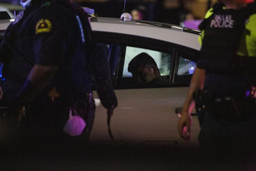 Dallas police arrested a protester at a Friday march.