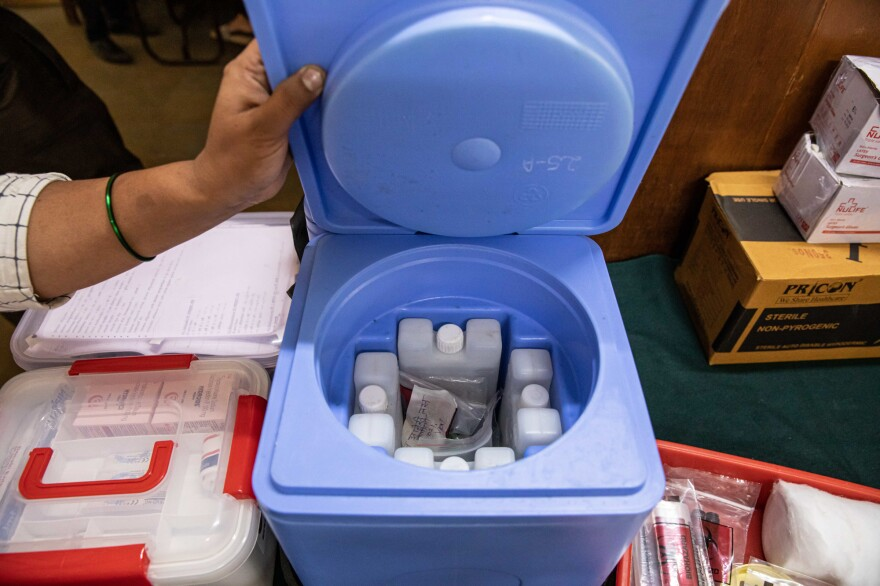 Vials of vaccine are stored in this container.