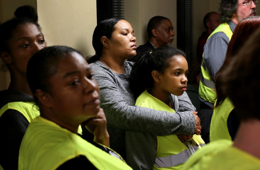 In March 2016, more than a dozen activists wore yellow vests and silently interrupted a city council forum to urge the city to agree to the U.S. Department of Justice's proposed consent decree. Fran Griffin participated with her daughter.