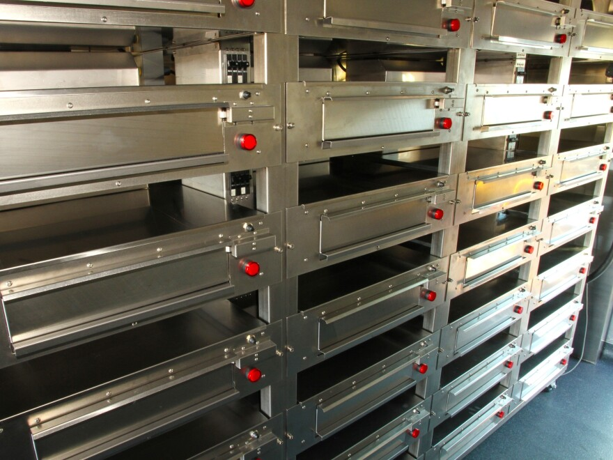 The racks lock into place so the ovens stay still while the delivery truck is being driven.