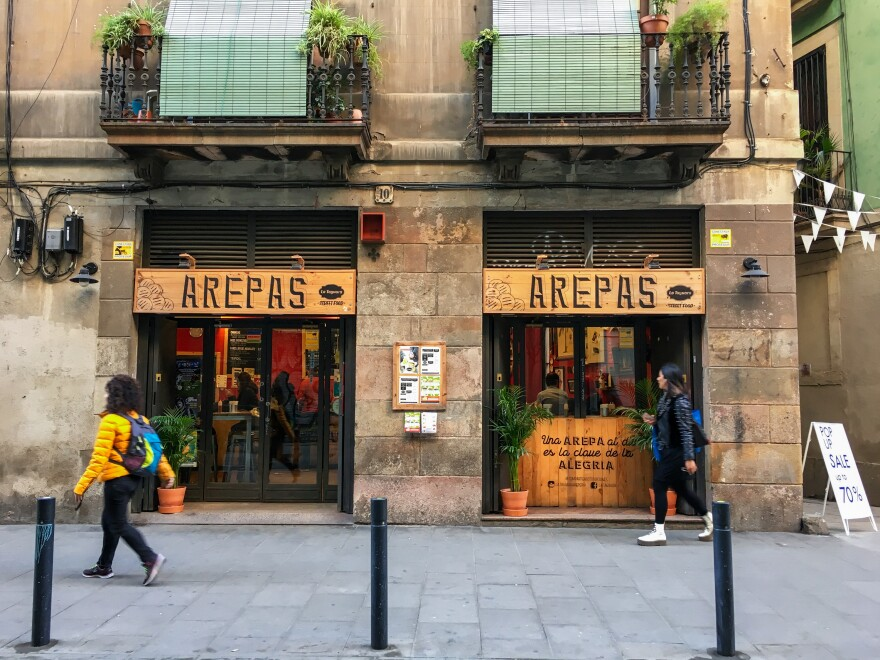 A restaurant named after the traditional Venezuelan dish, Arepas, is run by Venezuelan migrants in downtown Barcelona, Spain. Since 2015, the number of Venezuelans registered as living in Spain has grown from 165,000 to more than 255,000.