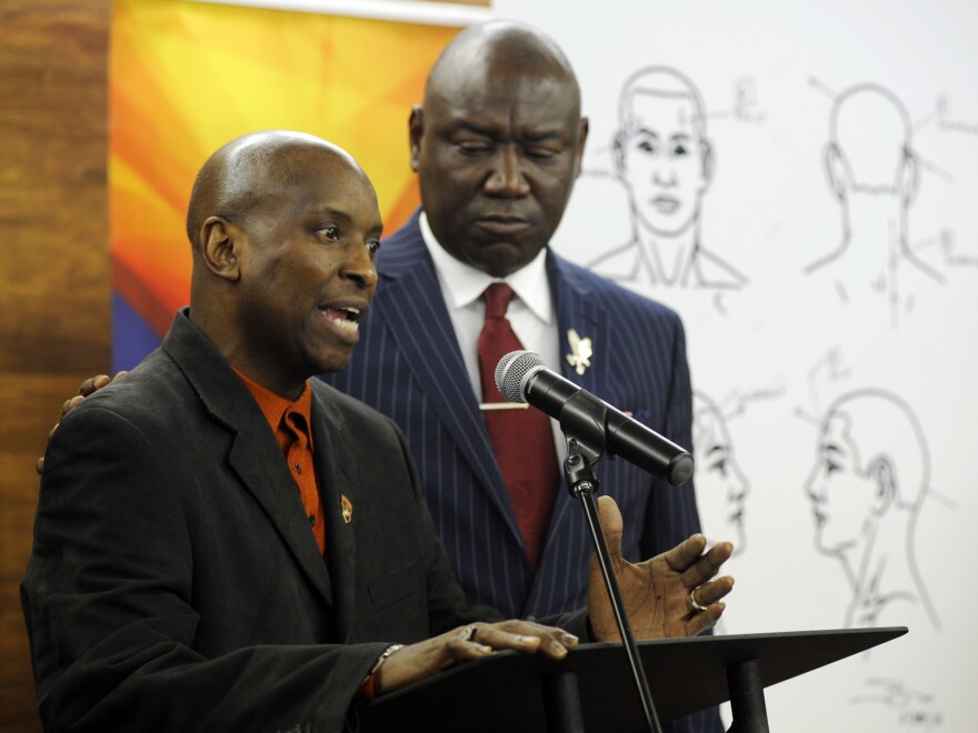 """Flanked by attorney Ben Crump, Emantic Bradford Sr. discusses the results of a forensic examination on his son Emantic """"EJ"""" Bradford Jr., who was fatally shot by police after a shooting in a shopping mall on Thanksgiving Day, after being mistaken for a suspect."""