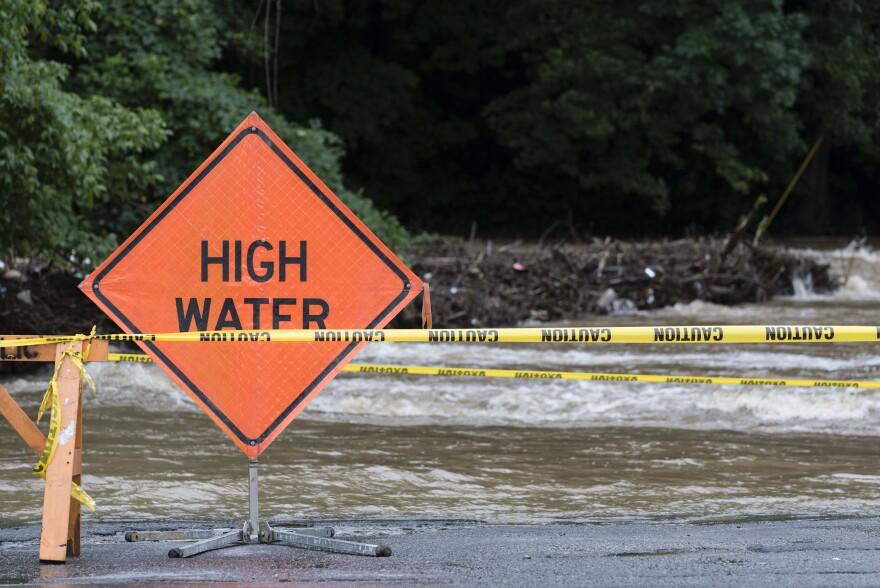 File photo: Deckers Creek runs over a bridge June 23, 2017, in Morgantown, W.Va.