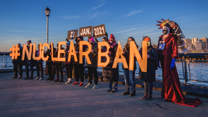 People hold letters reading #NUCLEARBAN in New York City, in support of the Treaty on the Prohibition of Nuclear Weapons, which took effect on Friday.