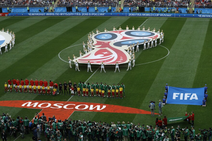 The teams of Russia and Saudi Arabia line up prior to their group A march which opens the 2018 soccer World Cup at the Luzhniki stadium in Moscow, Russia, Thursday, June 14, 2018. (Victor Caivano/AP)