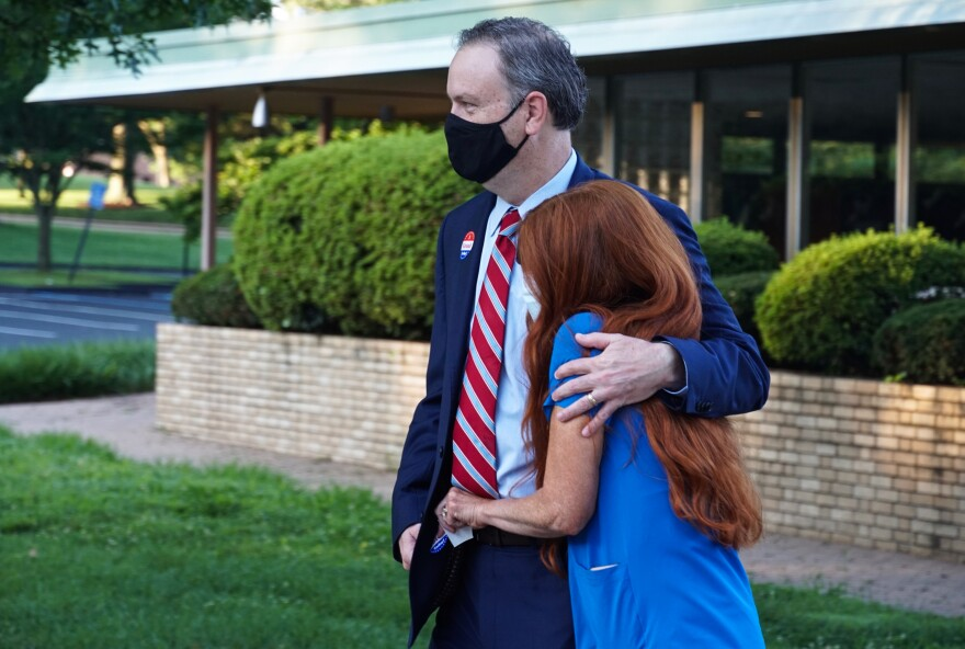 St. Louis County Executive Sam Page and his wife, Dr. Jennifer Page, walk away from their polling station at the First Church of Christ Scientist in Creve Coeur early Tuesday morning, Aug. 4, 2020.