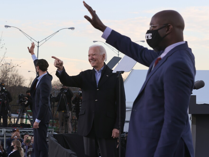 President-elect Joe Biden campaigns alongside Democratic candidates for the Senate Jon Ossoff, left, and Rev. Raphael Warnock, right.