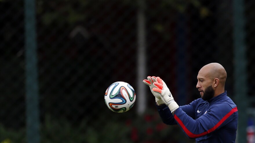 """United States' goalkeeper Tim Howard works out during a training session. """"We're going to do our best to bottle him up,"""" Howard said of Portugal's forward Cristiano Ronaldo."""
