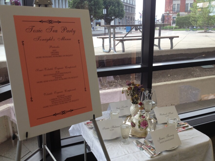 """A display protesting the US EPA's proposed clean-up plan for the Tremont City Barrel Fill, """"Toxic Tea Party,"""" was set-up at the City Hall forum held by People for Safe Water."""