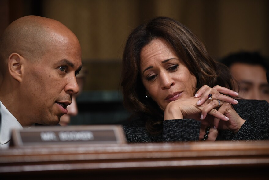 Sens. Cory Booker (L) and Kamala Harris (R) during a Senate Judiciary Committee hearing. Both senators are weighing whether to run for president.