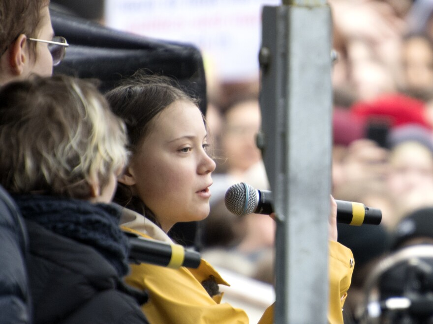 Swedish activist Greta Thunberg, right, speaks during a climate change demonstration in Stockholm on Friday. Thunberg has been leading protests to demand action on climate change and has inspired students across the world.