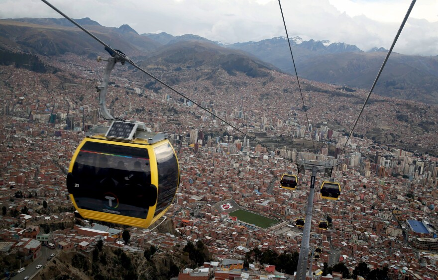 The first of eight proposed cable lines linking Bolivia's capital La Paz (shown in the background) with El Alto was opened earlier this year. The government hopes the cable cars will ease the chronic congestion.
