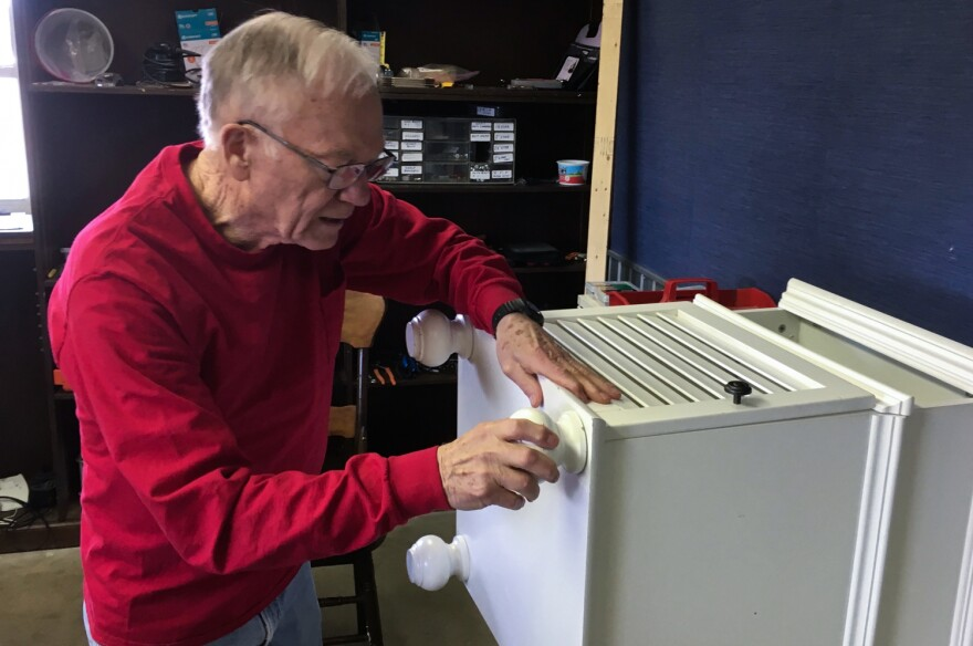 Bob Pennycuick, 80, secures the foot of a piece of furniture on Feb 27, 2019 at Home Sweet Home, where he volunteers several days a week.
