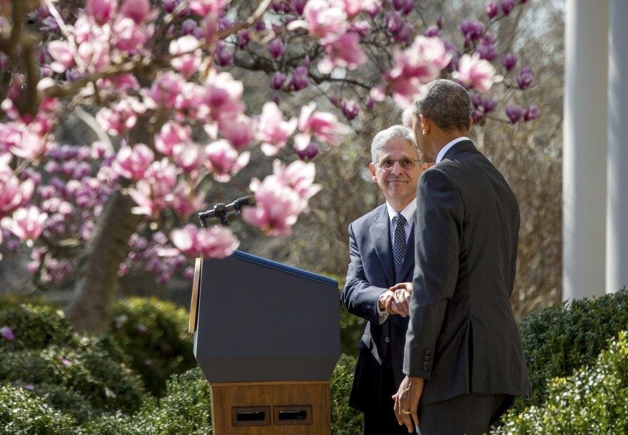 Supreme Court nominee Merrick Garland shakes hands with President Obama in the Rose Garden of the White House on March 16.