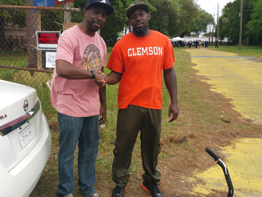 The author (left) and North Charleston resident Nathaniel Grant Junior, who happened to be wearing a Clemson tee, at the site of Walter Scott's killing.