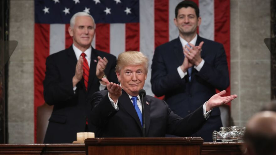 President Trump delivers the State of the Union address in January 2018 as Vice President Pence and then-Speaker of the House Paul Ryan look on in the chamber of the House of Representatives.