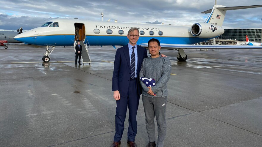 Xiyue Wang (right) stands with Brian Hook, the U.S. special representative for Iran, after a prisoner exchange late last year in Zurich, Switzerland.