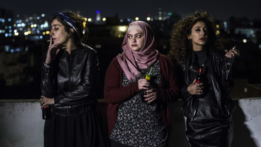 Salma (Sana Jammelieh), Nur (Shaden Kanboura) and Laila (Mouna Hawa) share a quiet moment <em>In Between</em>.