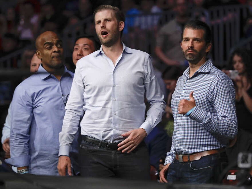 Donald Trump Jr., right, poses for a photo with Eric Trump at UFC Fight Night Saturday, Aug. 3, 2019, in Newark, N.J.