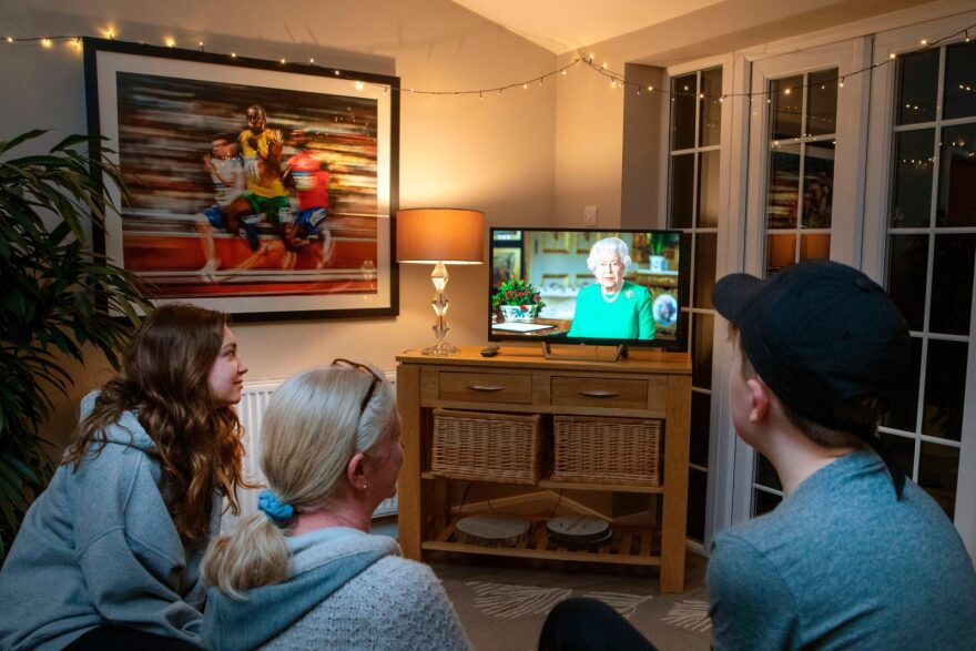 A family in the village of Hartley Wintney watches Britain's Queen Elizabeth II deliver a special address to the UK and  Commonwealth recorded at Windsor Castle in relation to the coronavirus outbreak.