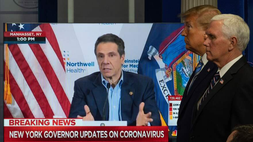 President Trump and Vice President Pence look on as a video plays of New York Gov. Andrew Cuomo giving a press conference in April.
