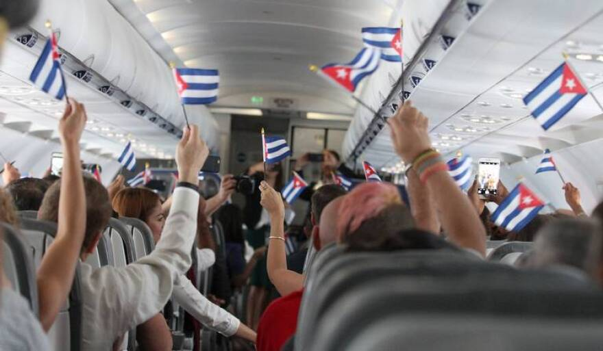 Americans wave Cuban flags on a flight from Fort Lauderdale to Cuba in 2016.