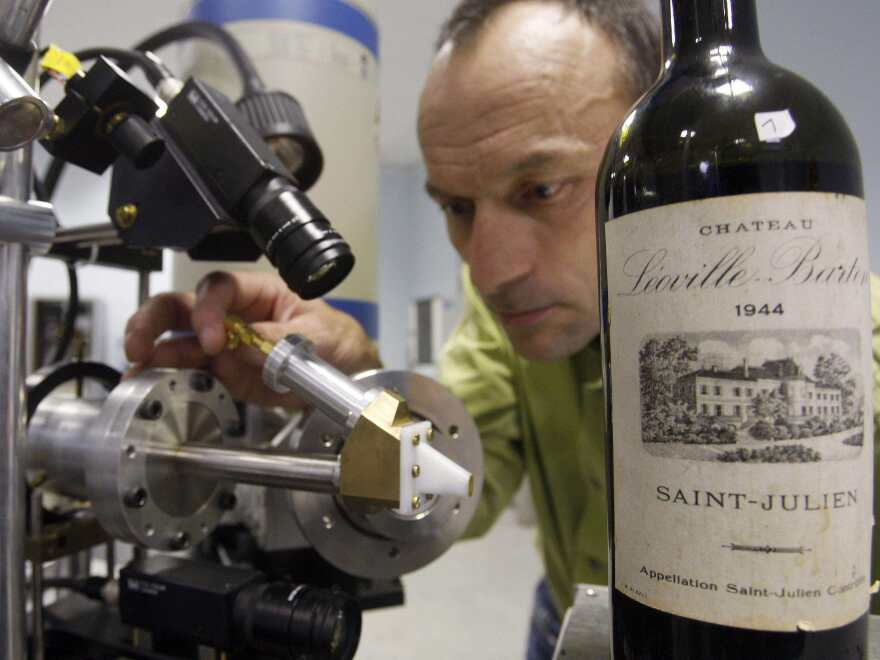 Herve Guegan of the Nuclear Research Centre of Bordeaux runs a test on a 1944 vintage bottle of Medoc wine.
