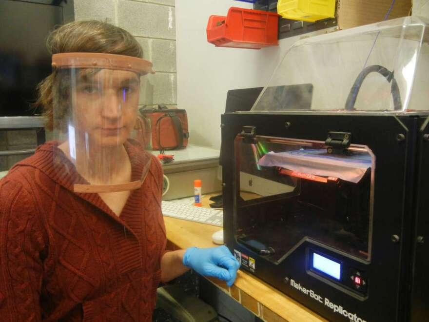 Kay Dartt monitors a 3D printer at Shepherd University.