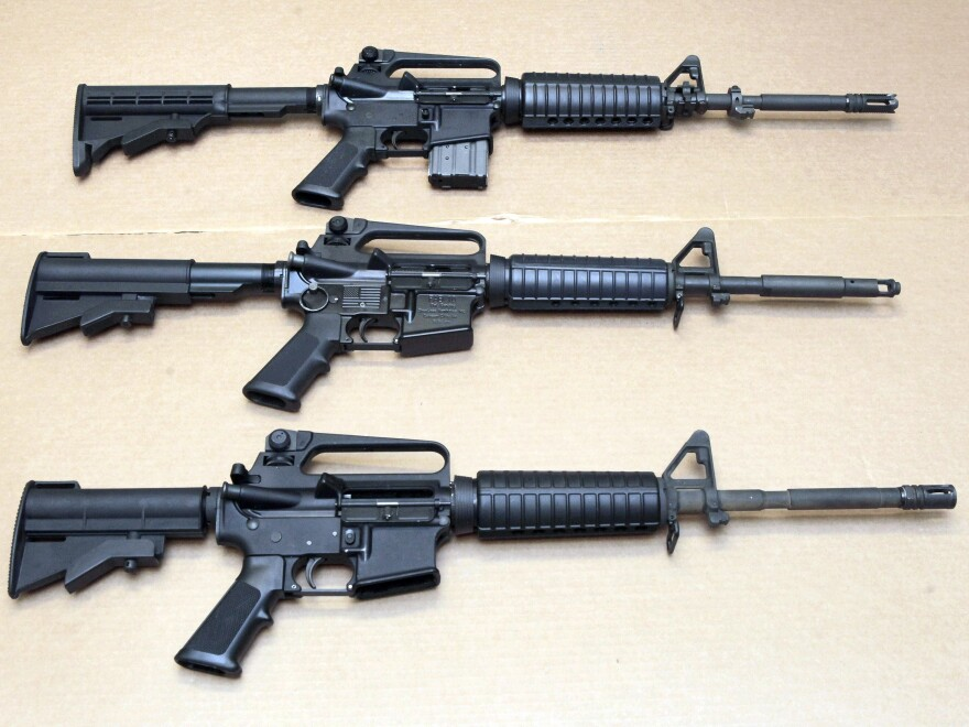 Three variations of the AR-15 rifle are displayed at the California Department of Justice in Sacramento, Calif., in a 2012 photo. On Thursday, Connecticut-based Colt's Manufacturing Co. said it was suspending production of its version of the AR-15 for the civilian market.