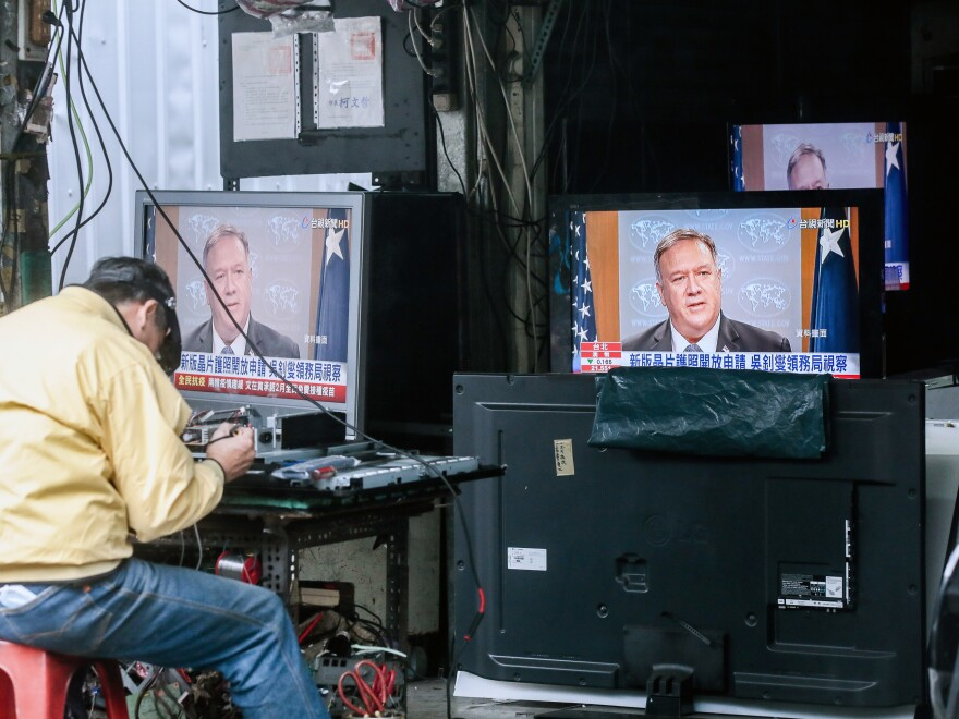 Televisions show a news broadcast of U.S. Secretary of State Mike Pompeo in Taipei, Taiwan, on Jan. 11. The Trump administration removed decades-old restrictions on interactions with Taiwanese officials just days before President-elect Joe Biden's inauguration.