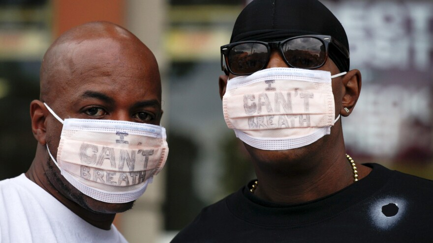 """New York City police are giving the Justice Department a deadline to announce criminal charges in the 2014 killing of Eric Garner. The death of Garner, who repeatedly told police """"I can't breathe,"""" spurred protests."""