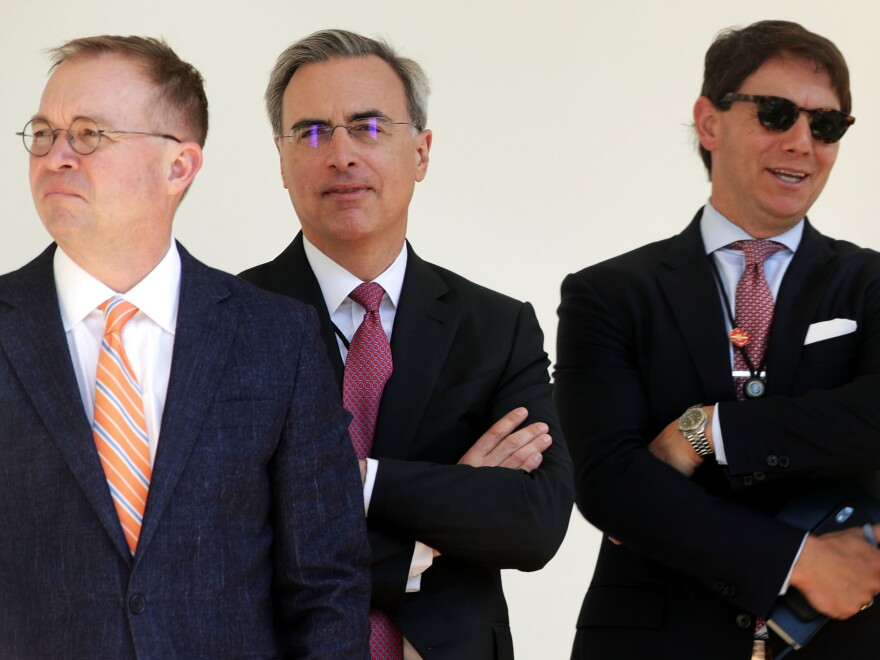 White House counsel Pat Cipollone (center) stands with acting Chief of Staff Mick Mulvaney (left) and spokesman Hogan Gidley at an event this year.