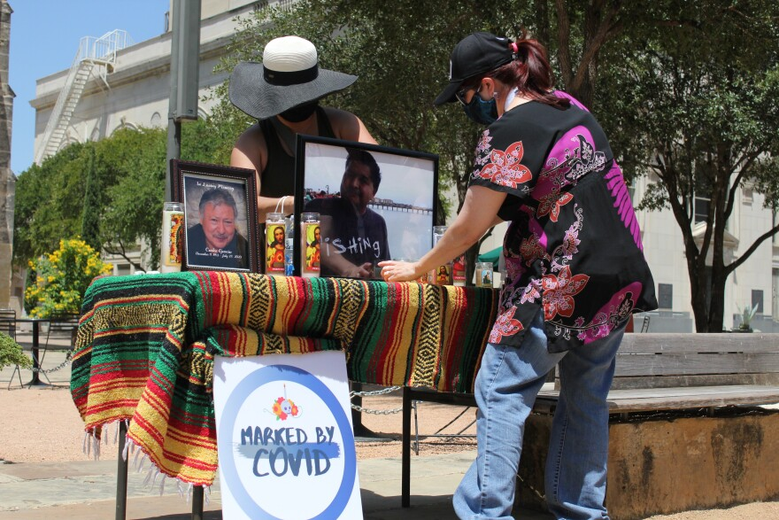 Rosemary Rangel Gutierrez and Brenda Li Garcia set up a vigil Thursday afternoon at Main Plaza for people who have died of COVID-19.