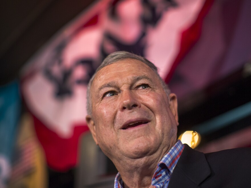 U.S. Rep. Dana Rohrabacher talks to reporters on election night in Costa Mesa, Calif. After days of ballot counting, Democratic challenger Rouda was declared the winner, ending Rohrbacher's nearly three decades-long career in Congress.