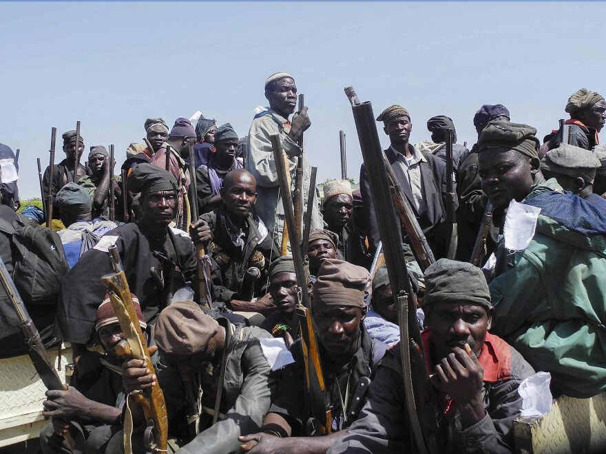 A group of Nigerian traditional hunters and vigilantes gather on vehicles on their way to engage Boko Haram militants in Mubi from Yola, Adamawa State, in November. The hunters have being assisting the Nigerian military in their fight against the Islamic insurgents.