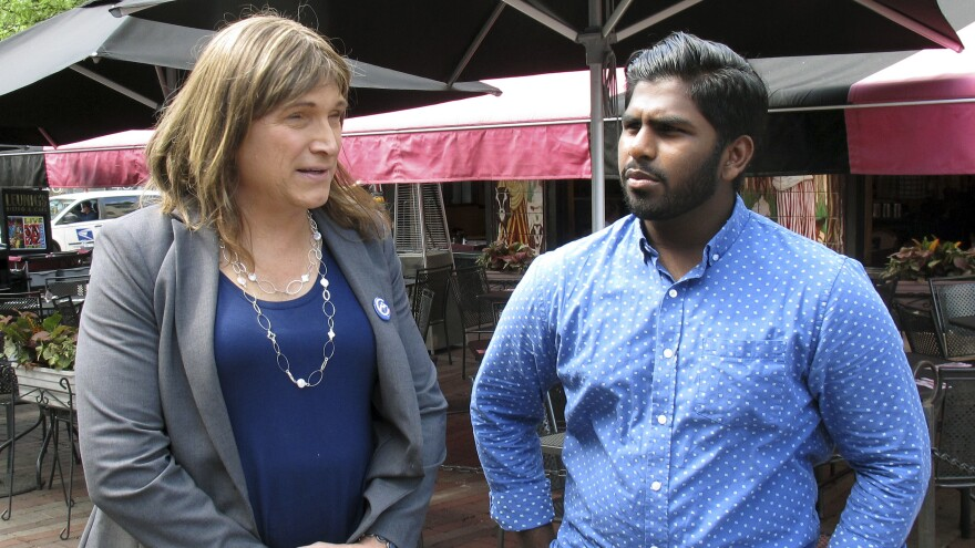 Christine Hallquist, a transgender candidate seeking the Democratic Party nomination to run for governor of Vermont, speaks with supporter Asfar Basha in Burlington.