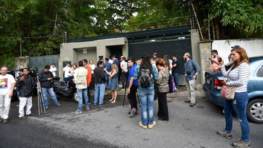 After Venezuelan opposition leader Leopoldo López was released from prison and placed under house arrest, his supporters and the media gathered outside his house in Caracas Saturday.
