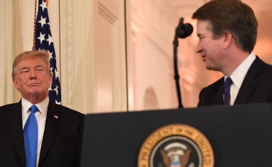 President Trump looks on as Judge Brett Kavanaugh speaks after being nominated to the Supreme Court last month.