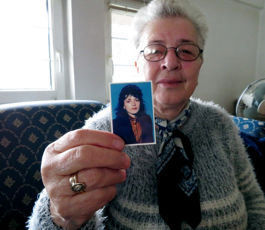 """Sanije Salihu, 70, of Gjakova, eastern Kosovo, holds up a photo of her daughter, Vjollca, at age 20. Vjollca was violently raped and beaten during the 1998-1999 war with Serbia and was left paralyzed. She died in 2006. """"If she had died during the war, [Kosovo] would have mourned her,"""" Salihu says. """"My heart aches that she wasted away like she was nothing."""""""