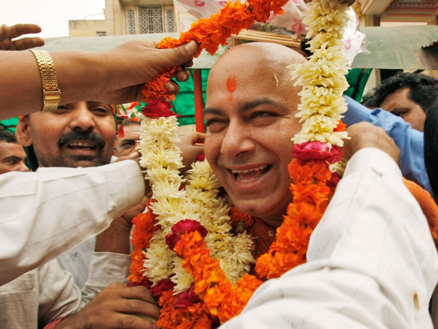 Bhratiya Janata Party leader Vijay Jolly is garlanded as he comes out of Lord Hanuman or the monkey god's temple after taking his blessings for contesting in the state elections  in New Delhi on Nov. 11, 2008.