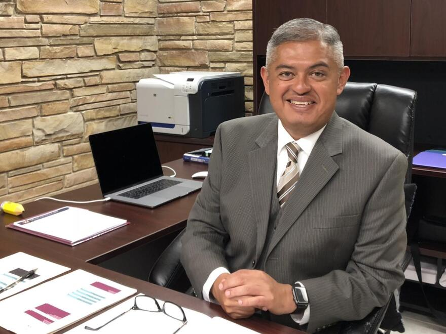 Edgewood superintendent Eduardo Hernandez poses for a portrait in his office in July 2018.