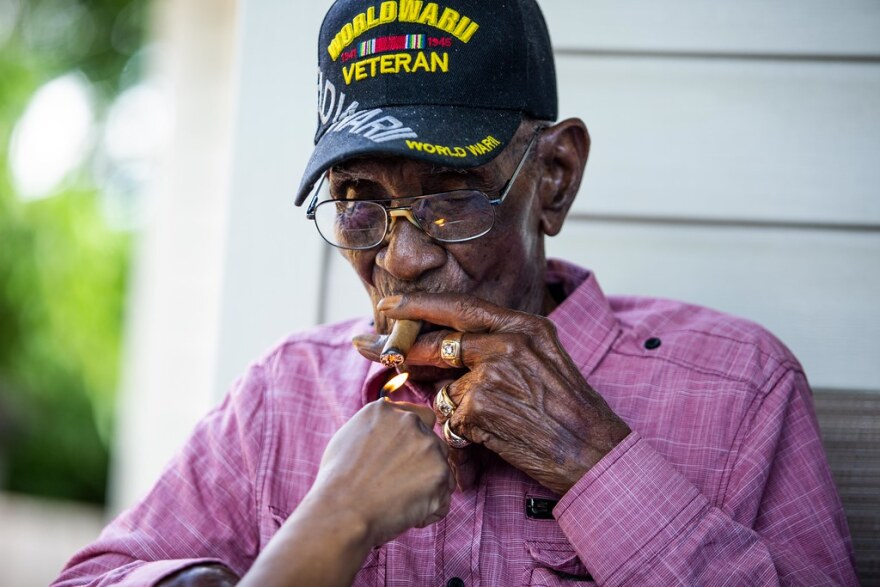 Richard Overton lights a cigar