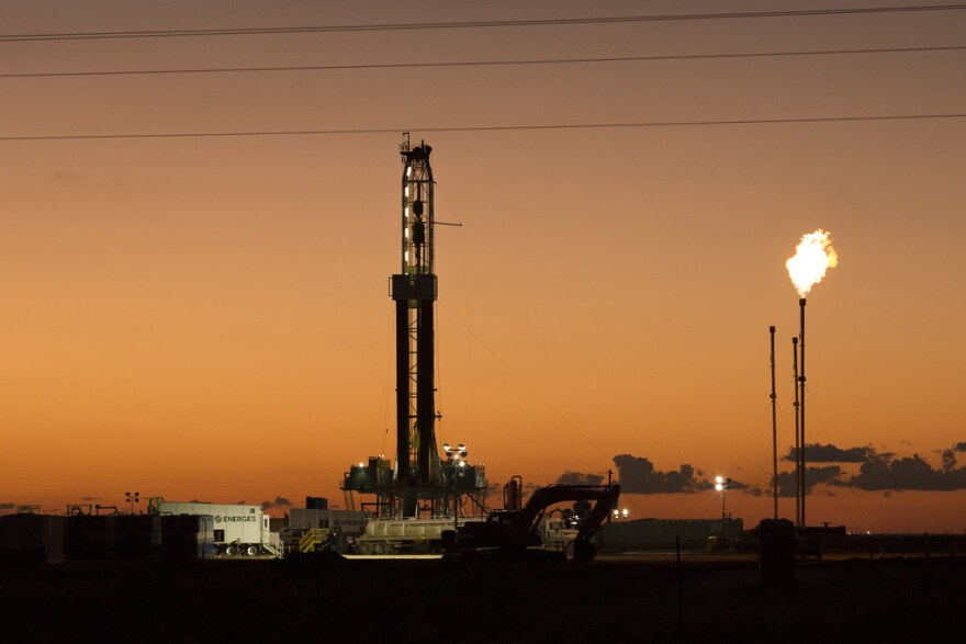 An oil rig and gas flares in Far West Texas.