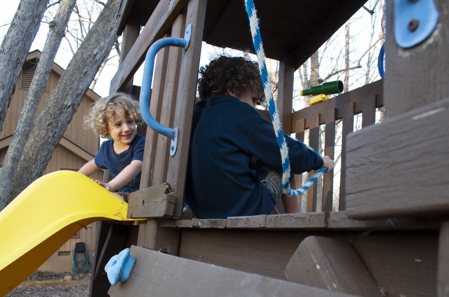 Mateo, left, and his older brother Caleb play in their backyard in Chapel Hill, North Carolina. Kindergartener Caleb practices lockdown drills at his school, while his little brother Mateo hasn't started yet.